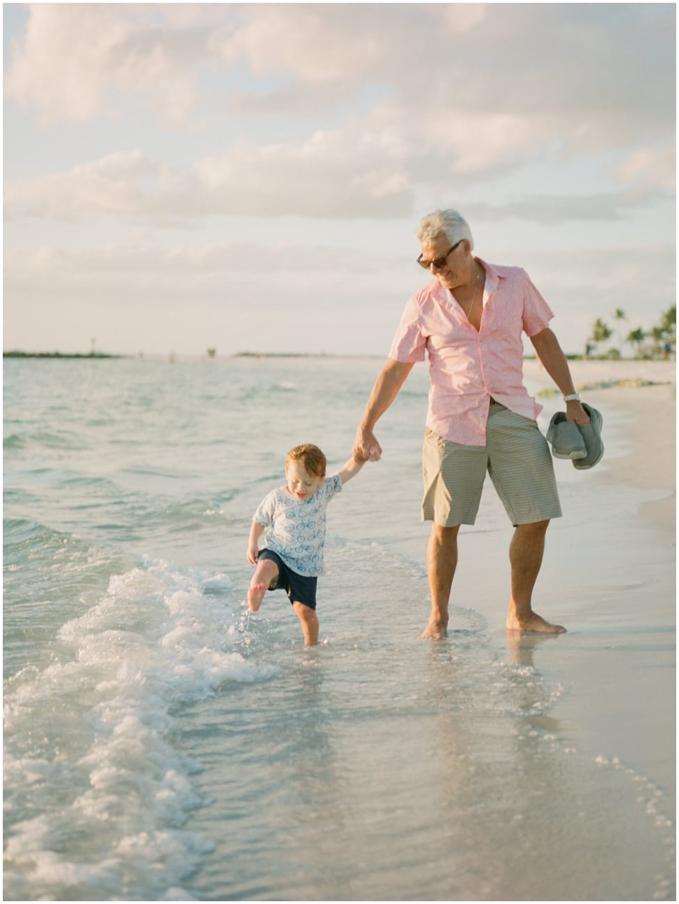 grandpa and grandson walking in naples florida for family shoot